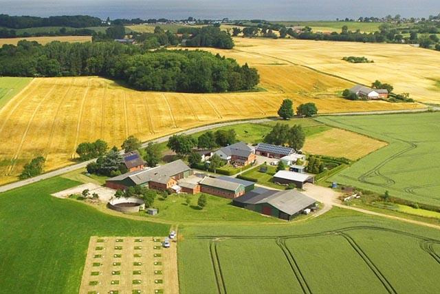 Photo of a farm surrounded by farmland